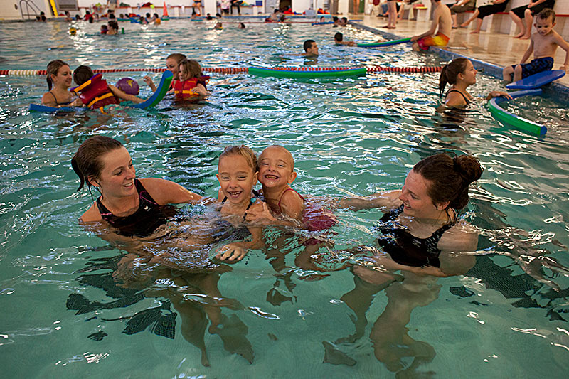 Students and children enjoying the Acadia pool facility