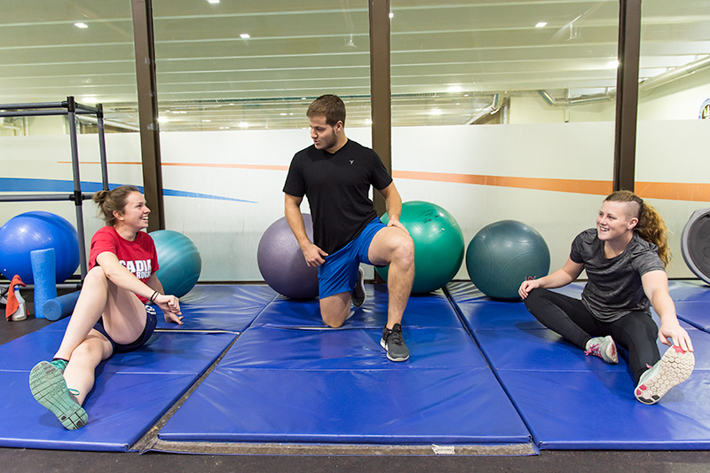 Students stretch in the fitness centre