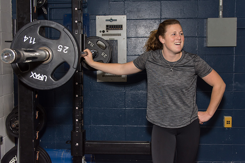 A student athlete enjoys the weightlifting area